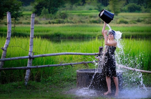 Girl washes in groundwater